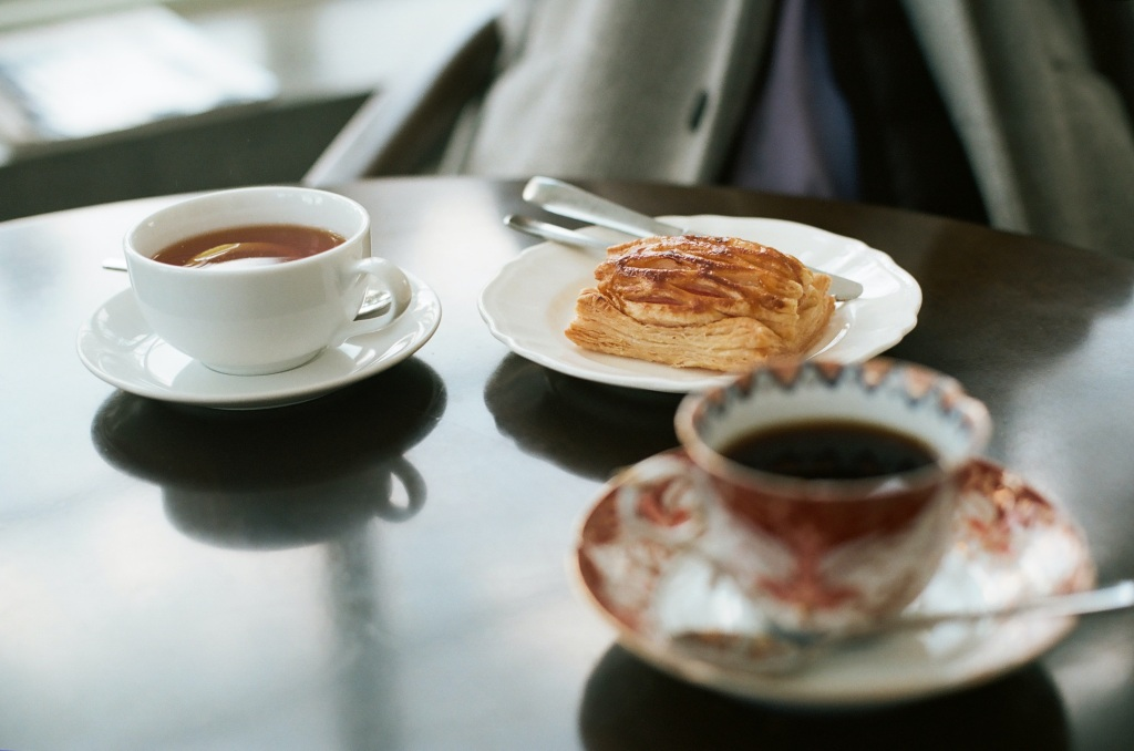 Image showing two cups of tea or coffee and a pastry